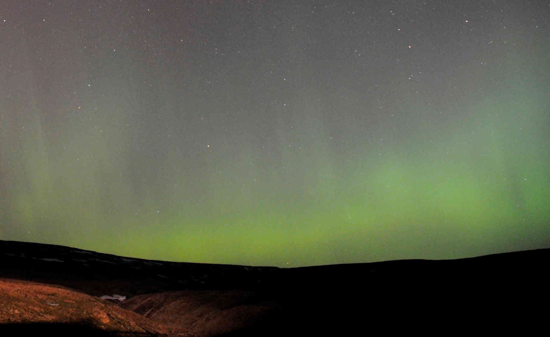 Image of the Northern Lights in a landscape