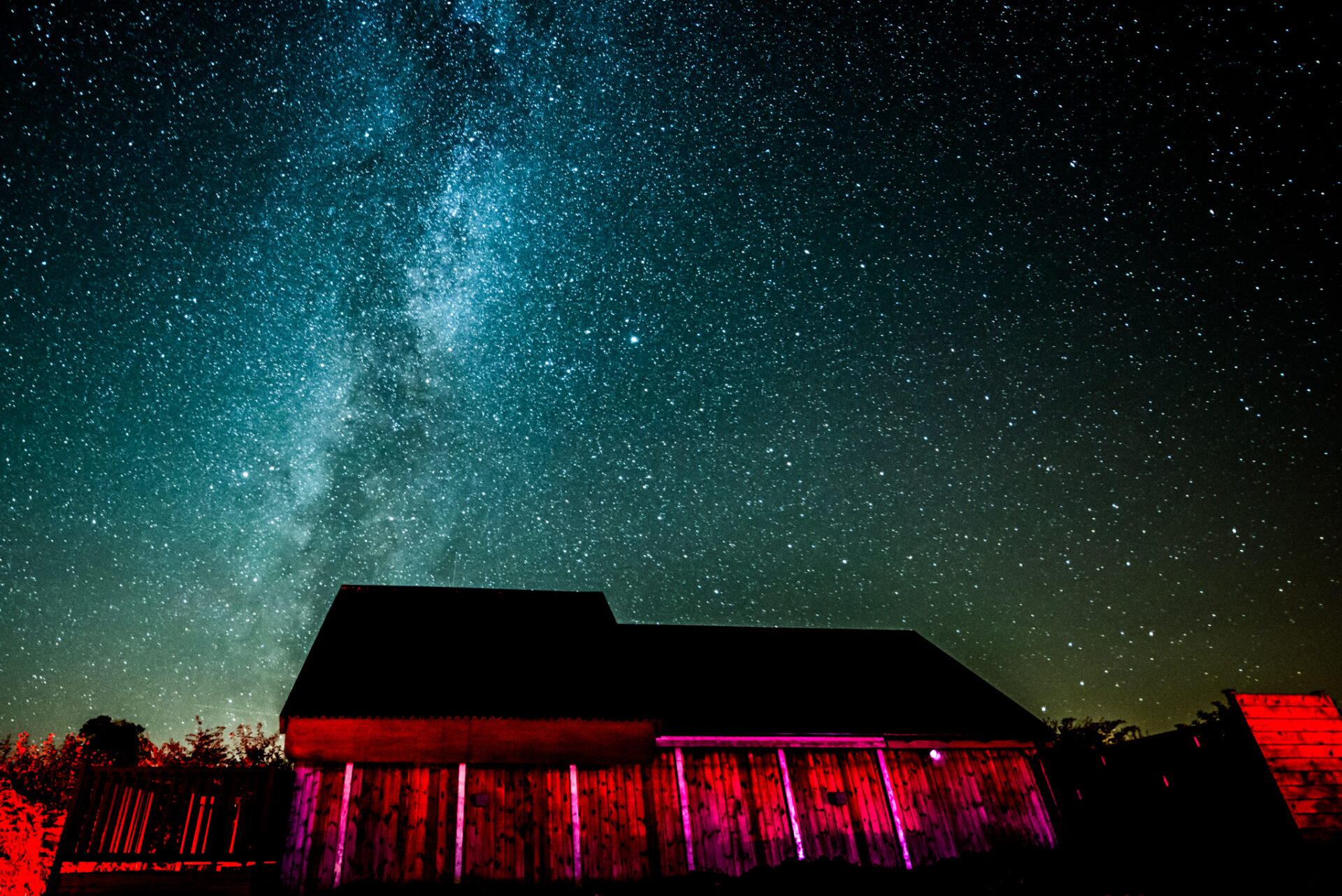 A night sky image of Battlesteads Observatory and the Milky Way