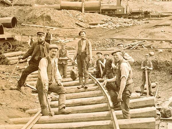 Photo of men working at Castle Carrock reservoir