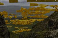 Image of artwork in landscape - yellow flags of fabric hung over a gully