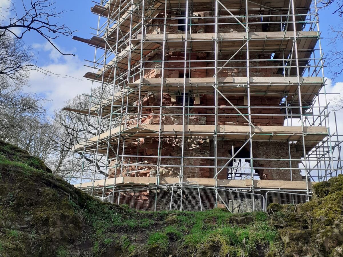 Image of ruined castle tower surrounded by scaffolding