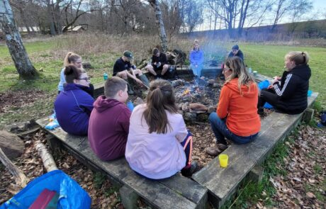 Image of group sitting around a campfire