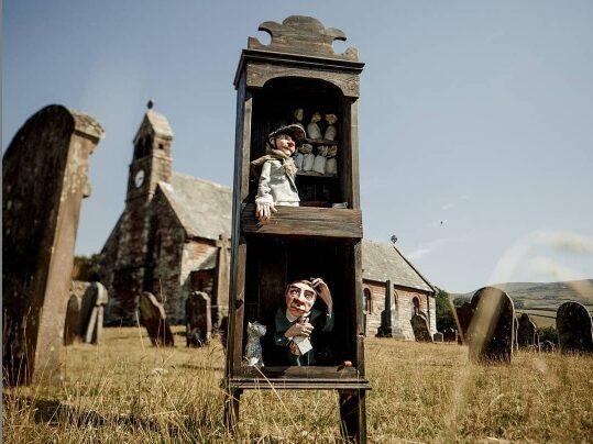 Image of automata in boxes in Croglin churchyard
