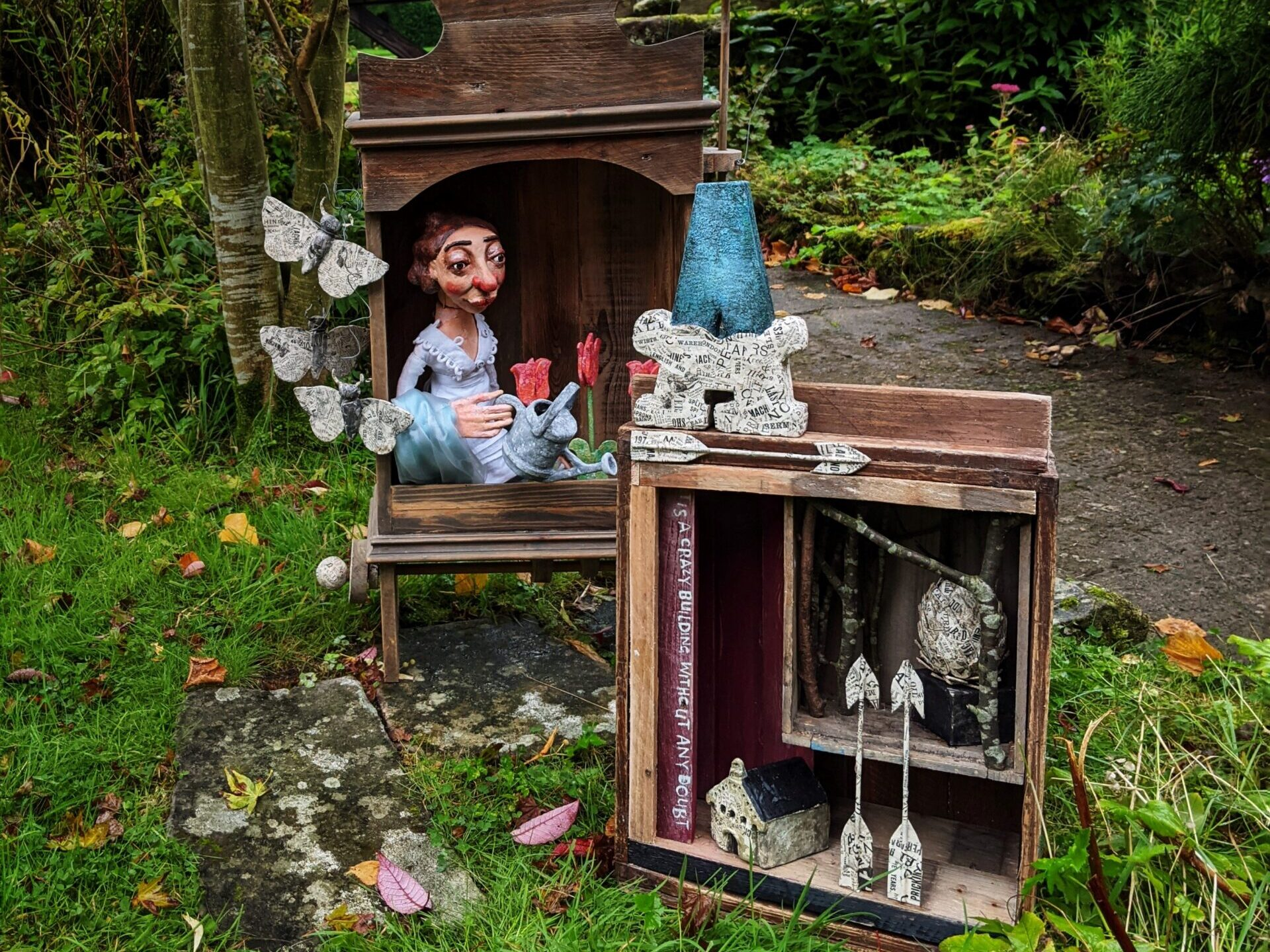 Image of an automata in a box outside on grass